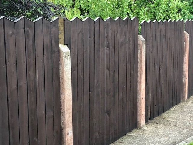 Garden fence painted with Creocote wood treatment